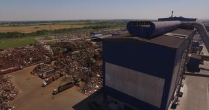 Top view of a metallurgical plant. Scrap heap, unloading of scrap metal factory, view from above, cover shot stock video