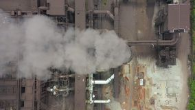 Top view of the metallurgical plant. Smoke coming out of factory pipes. stock video