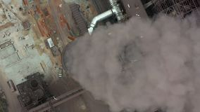 Top view of the metallurgical plant. Smoke coming out of factory pipes. stock footage