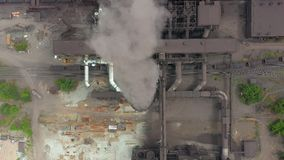 Top view of the metallurgical plant. Smoke coming out of factory pipes. stock video footage