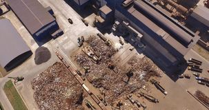 Top view of a metallurgical plant. Unloading of scrap metal factory, view from above, cover shot stock video