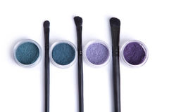 Top view of mineral eye shadows in pastel colors and brushes Stock Image