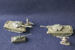 Scale models of toy plastic tanks and soldiers royalty free stock photography