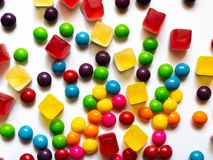 Top view of mix of colorful hard and jelly candies on white background stock photography