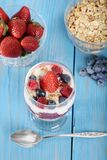 Top view mixed berry parfait with spoon Stock Photo