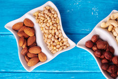 Top view at mixed of nuts in wave plate Royalty Free Stock Images