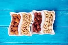 Top view at mixed of nuts in wave plate Stock Photo
