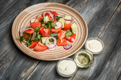 Top view of a mixed vegetable salad on ceramic plate Royalty Free Stock Image