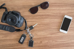 Top view Mobile camera car key glasses on the table. stock photos