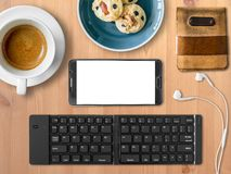 Smartphone mobile office set of digital nomad job. Top view of Mobile office working with smartphone and bluetooth keyboard in cafe as digital nomad job Royalty Free Stock Photography