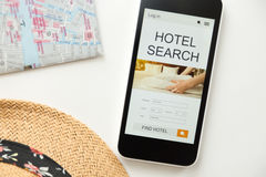 Top view of a mobile phone, hotel search on the screen Stock Photos