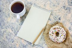 Notebook with blank white paper sheet ,coffee cup and donut. Top view mock up notebook with   blank  white paper sheet ,coffee cup and donut stock photos