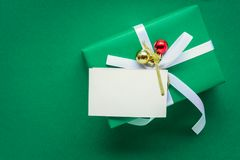 Top view mock up white text label and gift boxes on the green ta. Ble with the holiday season Stock Photo