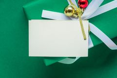 Top view mock up white text label and gift boxes on the green ta. Ble with the holiday season Royalty Free Stock Images