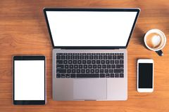 Top View Mockup Image Of Laptop With Blank White Screen , Tablet Pc , Mobile Phone And Coffee Cup Stock Photo