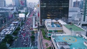 Top view of modern city with a large flow of cars standing in traffic. Aerial of a developed town with office buildings. And advanced infrastructure stock video footage