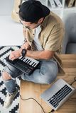 Modern dj working with MPC pad Royalty Free Stock Image