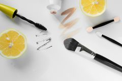Top view of modern fashion flat lay, fashion workspace with cosmetics and fresh lemons on white background Royalty Free Stock Photo