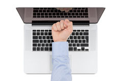 Top view of modern retina laptop with a man's fist pointing at t Royalty Free Stock Images
