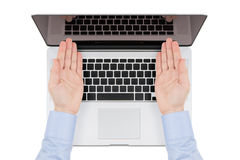 Top view of modern retina laptop with a man's hands directed tow Stock Photo