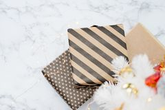 Top view of modern striped present box lay under white christmas royalty free stock photo