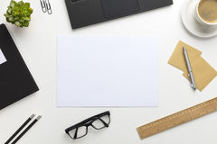 Top view of modern white office desk with notebook and supplies Royalty Free Stock Images