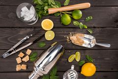 Top view of mojito cocktail ingredients and utensils on wooden table top cocktail. Drinks concept royalty free stock images