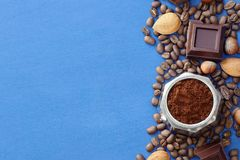 Blue background with coffee, chocolate, nuts royalty free stock images