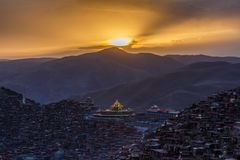 Top view monastery at Larung gar Buddhist Academy in sunset time. Sichuan, China Royalty Free Stock Image
