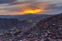 Top view monastery at Larung gar Buddhist Academy in sunset time. Sichuan, China Stock Photo