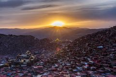 Top view monastery at Larung gar Buddhist Academy in sunset time. Sichuan, China Royalty Free Stock Photography