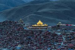 Top view monastery at Larung gar Buddhist Academy in sunset time. Sichuan, China Stock Images
