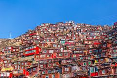 Top view monastery at Larung gar Buddhist Academy in sunshine day and background is blue sky. Sichuan, China Royalty Free Stock Photos
