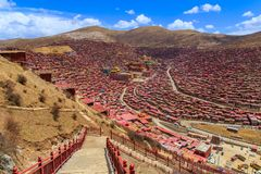 Top view monastery at Larung gar Buddhist Academy in sunshine day and background is blue sky. Sichuan, China Stock Image