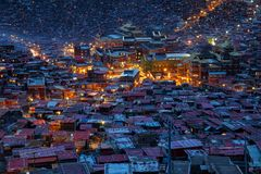 Top view monastery at Larung gar Buddhist Academy in twilight time. Sichuan, China Royalty Free Stock Image