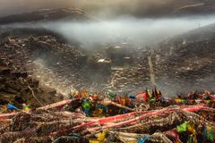 Top view monastery at Larung gar Buddhist Academy in a warm and foggy morning time. Sichuan, China Royalty Free Stock Image