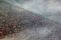 Top view monastery at Larung gar Buddhist Academy in a warm and foggy morning time. Sichuan, China Royalty Free Stock Photo