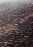 Top view monastery at Larung gar Buddhist Academy in a warm and foggy morning time. Sichuan, China Stock Photos