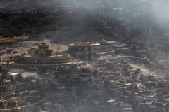 Top view monastery at Larung gar Buddhist Academy in a warm and foggy morning time. Sichuan, China Stock Image