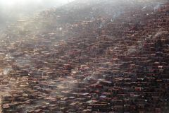 Top view monastery at Larung gar Buddhist Academy in a warm and foggy morning time. Sichuan, China Stock Images