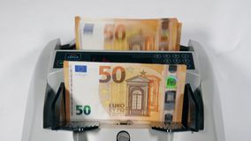 Top view of money-calculating machine with euros. 4K stock footage