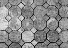 Top View of Monotone Grunge Gray Brick Stone on The Ground for Street Road. Sidewalk, Driveway, Pavers. Pavement in Vintage Design Flooring Hexagon Pattern stock image