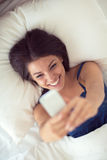 Top view of morning selfie in bed Stock Images