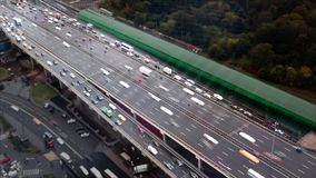Top view of the motorway with lots of cars. The effect of tilt shift stock video footage