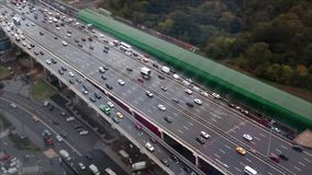 Top view of the motorway with lots of cars. The effect of tilt shift stock footage