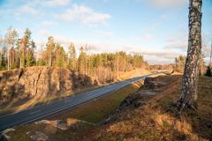 Top view from the mountain on the highway A-121 Sortavala in Karelia. Russia. Autumn landscape highway A-121 Sortavala in Karelia. Russia stock photography