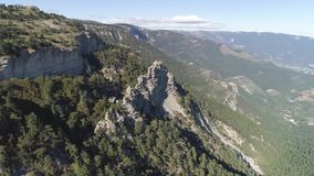 Top view of mountain landscape. Shot. Fantastic view of mountains with rock formations. Wooded green mountains against