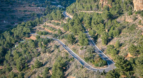 Top view of mountain road with u-shape curve Royalty Free Stock Photos