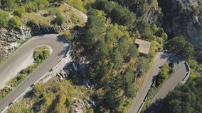 Top view of mountain turns of road. Stock. Dangerous and sharp turns on mountain road with forest areas. On mountain. Slopes you need to be very careful when royalty free stock photo