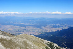 Top View of a Mountain Village. An aerial view of Bansko - famous ski resort in Bulgaria from the Vihren peak in the Pirin mountains Royalty Free Stock Photos